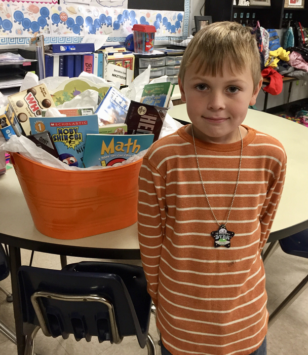 2nd grade Robert Howell won the movie night basket